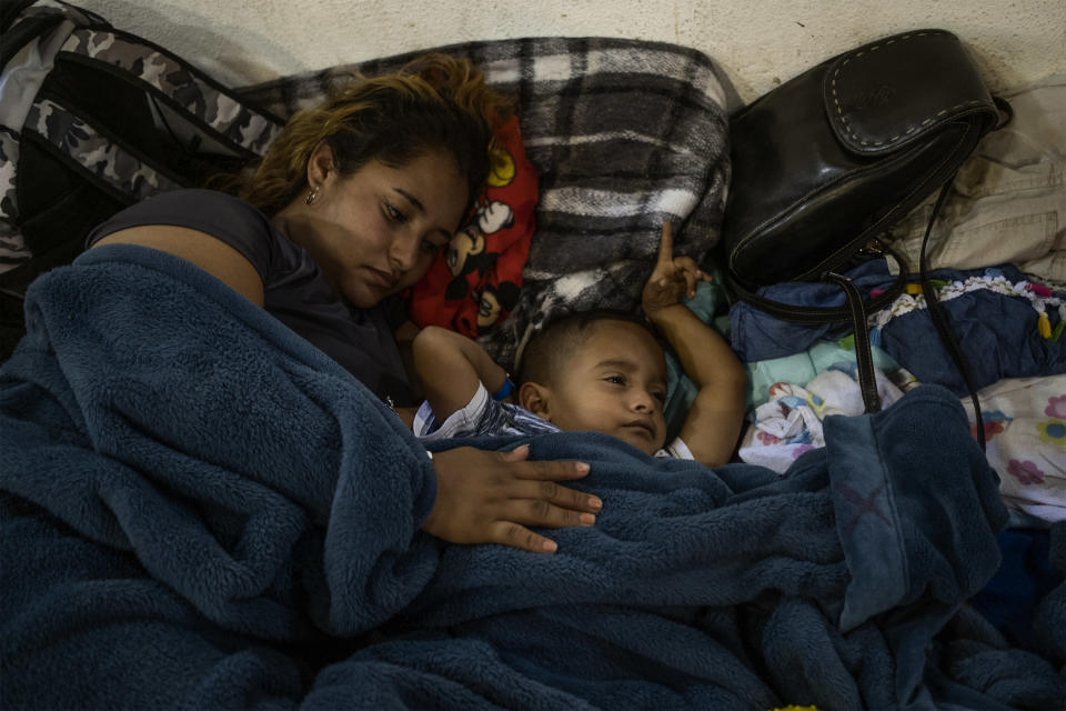 Xenia (19) and her son Kevin (4) rest at Tijuana's Barretal shelter, December 2, 2018. (Photo: Fabio Bucciarelli for Yahoo News)