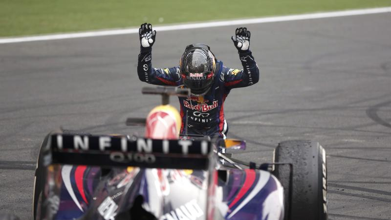 Red Bull Formula One driver Sebastian Vettel of Germany bows down in front of his car after winning the Indian F1 Grand Prix at the Buddh International Circuit in Greater Noida, on the outskirts of New Delhi, October 27, 2013. Vettel became Formula One's youngest four-times world champion on Sunday after winning the Indian Grand Prix for Red Bull. Red Bull also took the constructors' championship for the fourth year in a row. The victory from pole position was the 26-year-old's sixth in a row and completed a hat-trick of wins in India where no other driver has ever won since the race made its debut in 2011. REUTERS/Adnan Abidi (INDIA - Tags: SPORT MOTORSPORT F1 TPX IMAGES OF THE DAY)