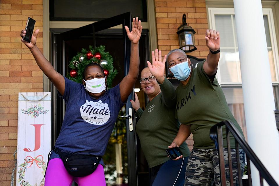 <p>People reacted on the streets of the Mount Airy neighborhood in Philadelphia on Saturday, moments after Biden was projected as the winner of the election.</p>