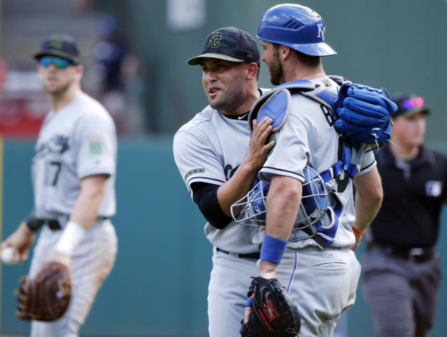 Kansas City Royals relief pitcher Kelvin Herrera, front left, is congratulated by catcher Drew Butera after they defeated the Texas Rangers in a baseball game Sunday, May 27, 2018, in Arlington, Texas. (AP Photo/Michael Ainsworth)