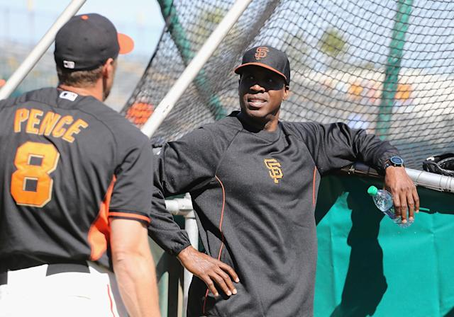 SCOTTSDALE, AZ - MARCH 10: Barry Bonds of the San Francisco Giants speaks with Hunter Pence #8 as a special hitting coach for one week of Spring Training during batting practice at Scottsdale Stadium on March 10, 2014 in Scottsdale, Arizona. (Photo by Christian Petersen/Getty Images)