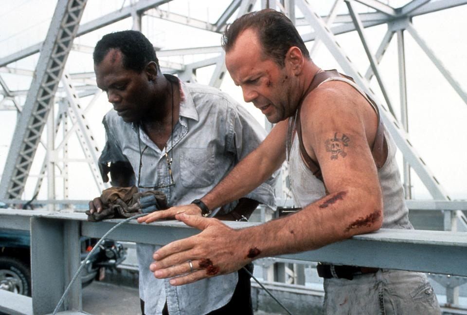 Samuel L Jackson and Bruce Willis standing on a bridge, looking down in a scene from the film 'Die Hard: With a Vengeance', 1995. (Photo by 20th Century-Fox/Getty Images)
