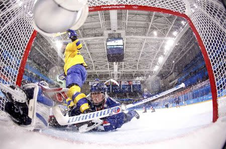 Ice Hockey – Pyeongchang 2018 Winter Olympics – Women Preliminary Round Match - Sweden v Korea - Kwandong Hockey Centre, Gangneung, South Korea – February 12, 2018 - Hwang Chung Gum of Korea in action. REUTERS/Kim Kyung-Hoon
