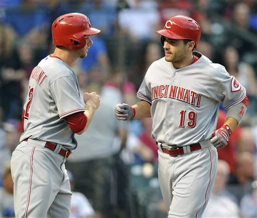 Cincinnati Reds' Tony Cingrani left, congratulates Joey Votto (19) after his two-run home run against the Chicago Cubs during the third inning of a baseball game Tuesday, June 11, 2013, in Chicago. (AP Photo/Jim Prisching)