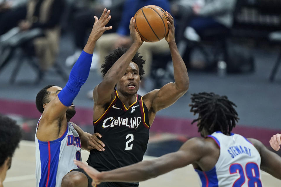 Cleveland Cavaliers' Collin Sexton (2) shoots over Detroit Pistons' Isaiah Stewart (28) and Wayne Ellington (8) in the first half of an NBA basketball game, Wednesday, Jan. 27, 2021, in Cleveland. (AP Photo/Tony Dejak)
