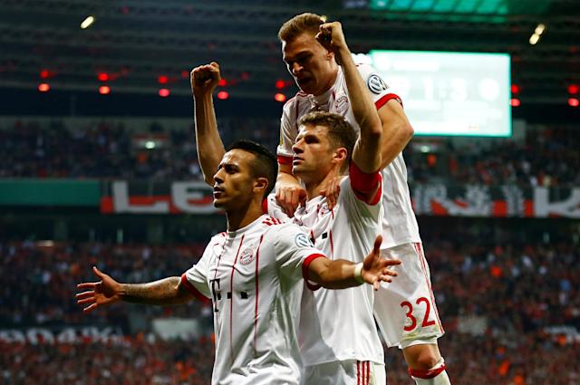 Soccer Football - DFB Cup - Bayer Leverkusen vs Bayern Munich - BayArena, Leverkusen, Germany - April 17, 2018 Bayern Munich's Thiago Alcantara celebrates scoring their fourth goal REUTERS/Wolfgang Rattay DFB RULES PROHIBIT USE IN MMS SERVICES VIA HANDHELD DEVICES UNTIL TWO HOURS AFTER A MATCH AND ANY USAGE ON INTERNET OR ONLINE MEDIA SIMULATING VIDEO FOOTAGE DURING THE MATCH. TPX IMAGES OF THE DAY
