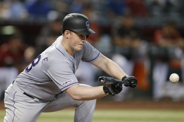 Colorado Rockies' Tim Melville bunts for an RBI sacrifice in the sixth inning during a baseball game against the Arizona Diamondbacks, Wednesday, Aug. 21, 2019, in Phoenix. (AP Photo/Rick Scuteri)