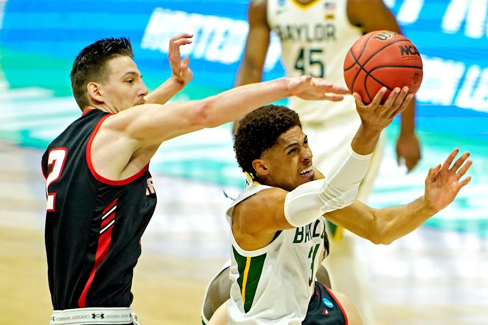 Mar 19, 2021; Indianapolis, Indiana, USA; Baylor Bears guard MaCio Teague (31) shoots the ball against Hartford Hawks forward Miroslav Stafl (12) during the first half during the first round of the 2021 NCAA Tournament at Lucas Oil Stadium. Mandatory Credit: Andrew Nelles-USA TODAY Sports