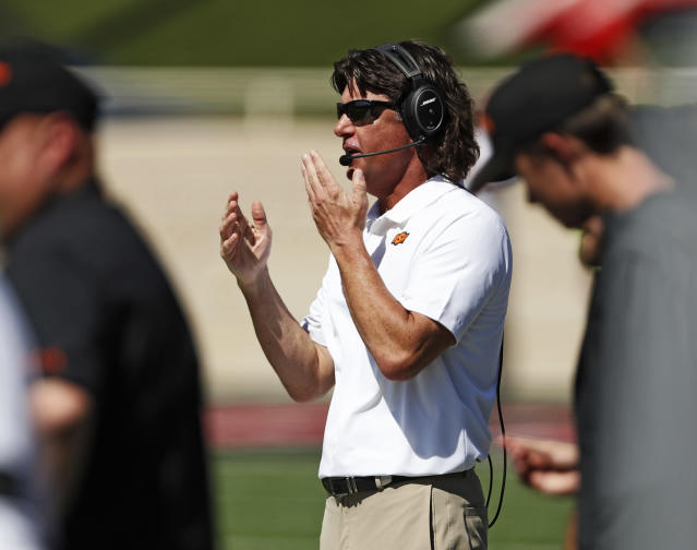 Oklahoma State coach Mike Gundy reacts to a play during the second half of an NCAA college football game against Texas Tech, Saturday, Oct. 5, 2019, in Lubbock, Texas. (AP Photo/Brad Tollefson)