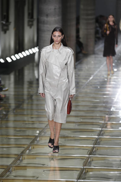 A model wears a creation as part of the Bottega Veneta Spring-Summer 2020 collection, unveiled during the fashion week, in Milan, Italy, Thursday, Sept. 19, 2019. (AP Photo/Antonio Calanni)