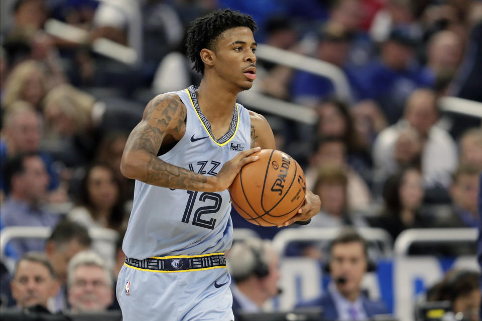 Memphis Grizzlies' Ja Morant (12) passes the ball during the second half of an NBA basketball game against the Orlando Magic, Friday, Nov. 8, 2019, in Orlando, Fla. (AP Photo/John Raoux)
