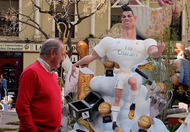 A figure representing soccer player Cristiano Ronaldo is depicted at a monument during the Fallas festival, which will terminate with the burning of 391 monuments in the early morning hours of March 20, in Valencia, Spain March 16, 2018. REUTERS/Heino Kalis