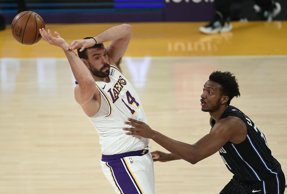 LOS ANGELES, CA - MARCH 28: Marc Gasol #14 of the Los Angeles Lakers loses control of the ball against Wendell Carter Jr. #34 of the Orlando Magic during the first half of the game at Staples Center on March 28, 2021 in Los Angeles, California. NOTE TO USER: User expressly acknowledges and agrees that, by downloading and or using this photograph, User is consenting to the terms and conditions of the Getty Images License Agreement. (Photo by Kevork Djansezian/Getty Images)