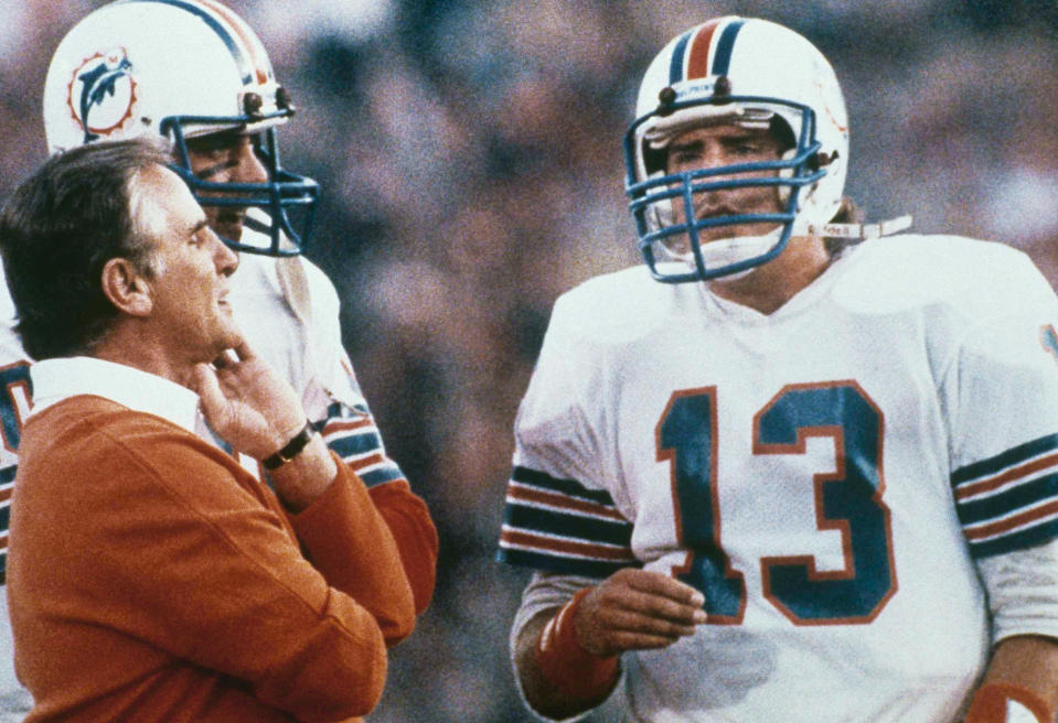Miami Dolphins quarterback Dan Marino confers with coach Don Shula on the sidelines during Super Bowl XIX. (AP Photo)