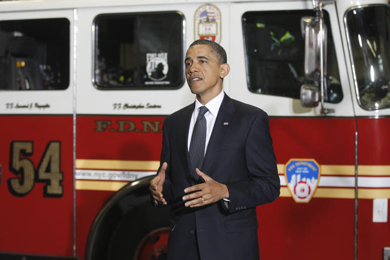 President Barack Obama speaks to firefighters and first responders at Engine 54, Ladder 4, Battalion 9 before visiting the National Sept. 11 Memorial at Ground Zero in New York, Thursday, May 5, 2011.