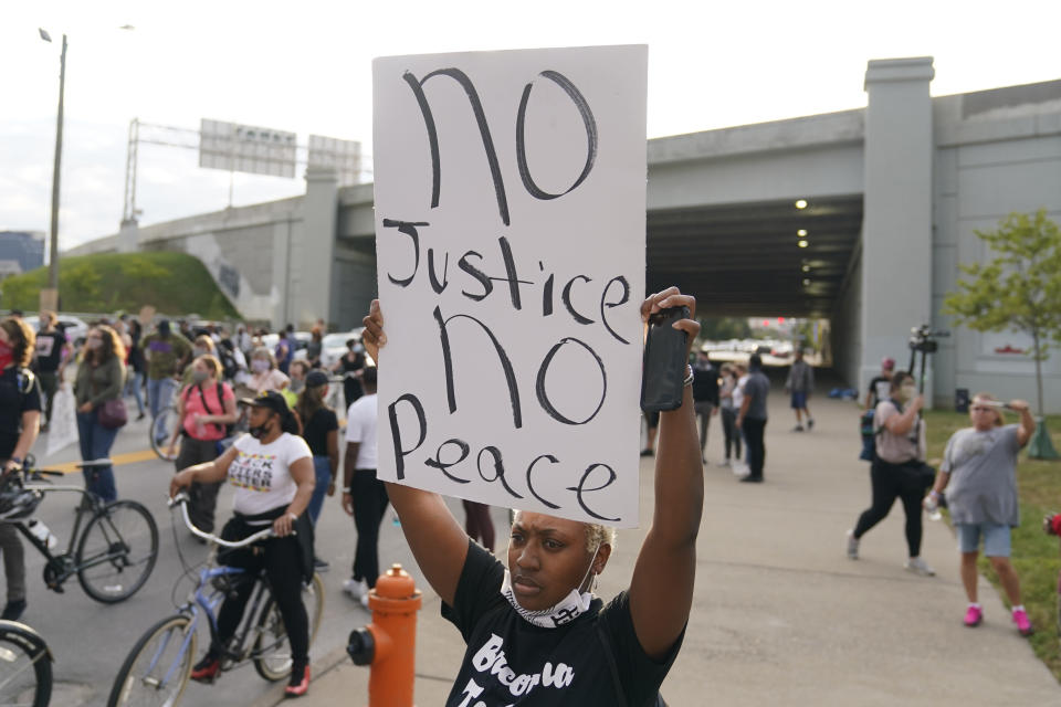 Victoria Gunther marches with Black Lives Matter protesters, Friday, Sept. 25, 2020, in Louisville. Breonna Taylor's family demanded Friday that Kentucky authorities release all body camera footage, police files and the transcripts of the grand jury hearings that led to no charges against police officers who killed the Black woman during a March drug raid at her apartment. (AP Photo/Darron Cummings)