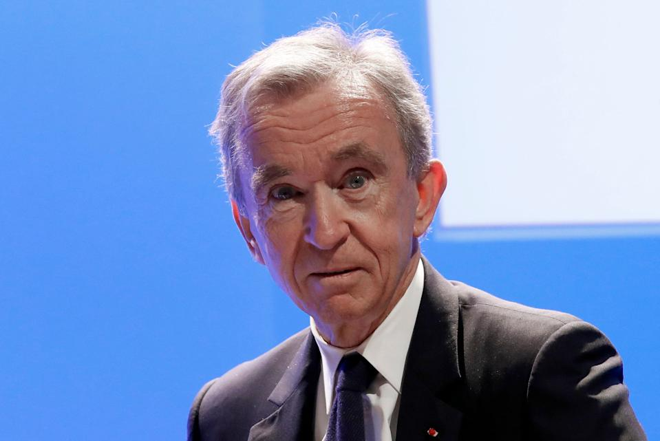 """FILE - In this Tuesday, Jan. 29, 2019 file photo CEO of LVMH Bernard Arnault arrives to present the group's 2018 results during a conference in Paris. As the France woke up in collective sadness at the fire damage to Notre Dame cathedral, its richest businessman, Bernard Arnault, and his luxury goods group LVMH answered that call with a pledge of 200 million euros ($226 million). A communique said that the Arnault family was """"in solidarity with this national tragedy, and join in the reconstruction of this extraordinary cathedral, a symbol of France, of its heritage and togetherness.""""(AP Photo/Christophe Ena, File)"""