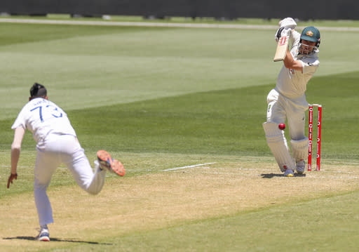 Australia's Travis Head bats during play on day one of the Boxing Day cricket test between India and Australia at the Melbourne Cricket Ground, Melbourne, Australia, Saturday, Dec. 26, 2020. (AP Photo/Asanka Brendon Ratnayake)