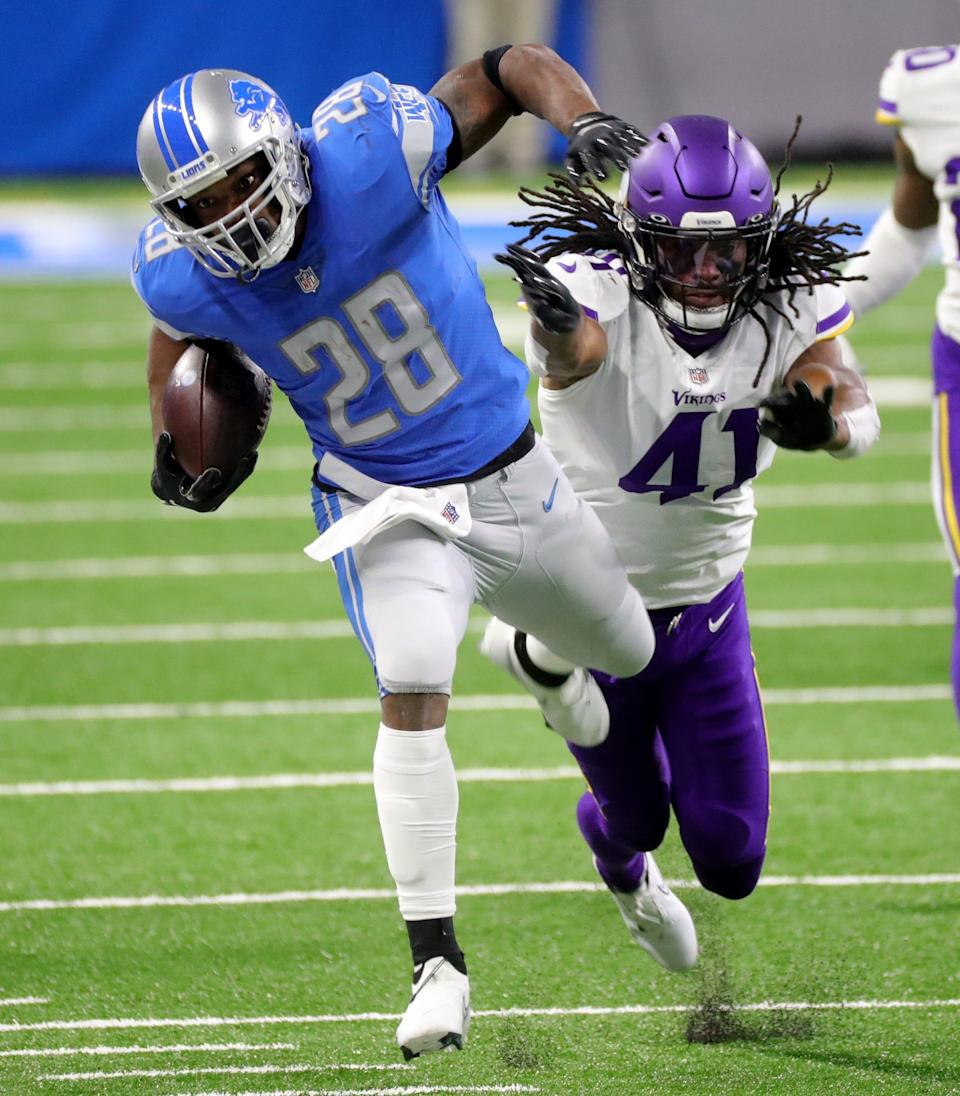 Detroit Lions running back Adrian Peterson is pushed out of bounds by Minnesota Vikings safety Anthony Harris during the first half at Ford Field, Sunday, Jan. 3, 2021.