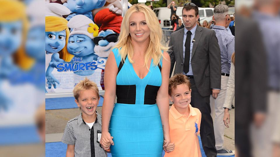 """Mandatory Credit: Photo by Jordan Strauss/Invision/AP/Shutterstock (9201325y)Singer Britney Spears, center, and her sons Sean Federline and Jayden James Federline arrive at the world premiere of """"The Smurfs 2"""" at the Regency Village Theatre on in Los AngelesWorld Premiere of The Smurfs 2 - Arrivals, Los Angeles, USA - 28 Jul 2013."""