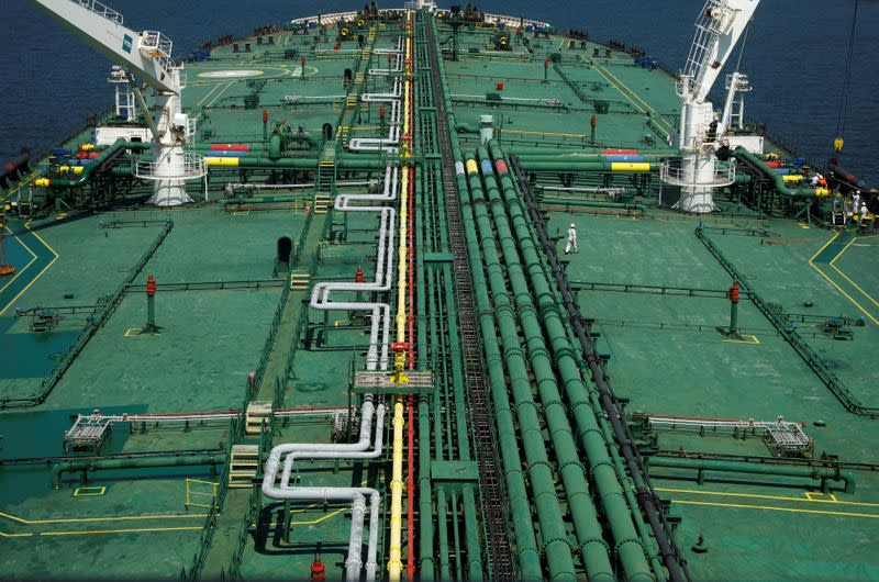 FILE PHOTO: Pipelines run down the deck of Hin Leong's Pu Tuo San VLCC supertanker in the waters off Jurong Island in Singapore