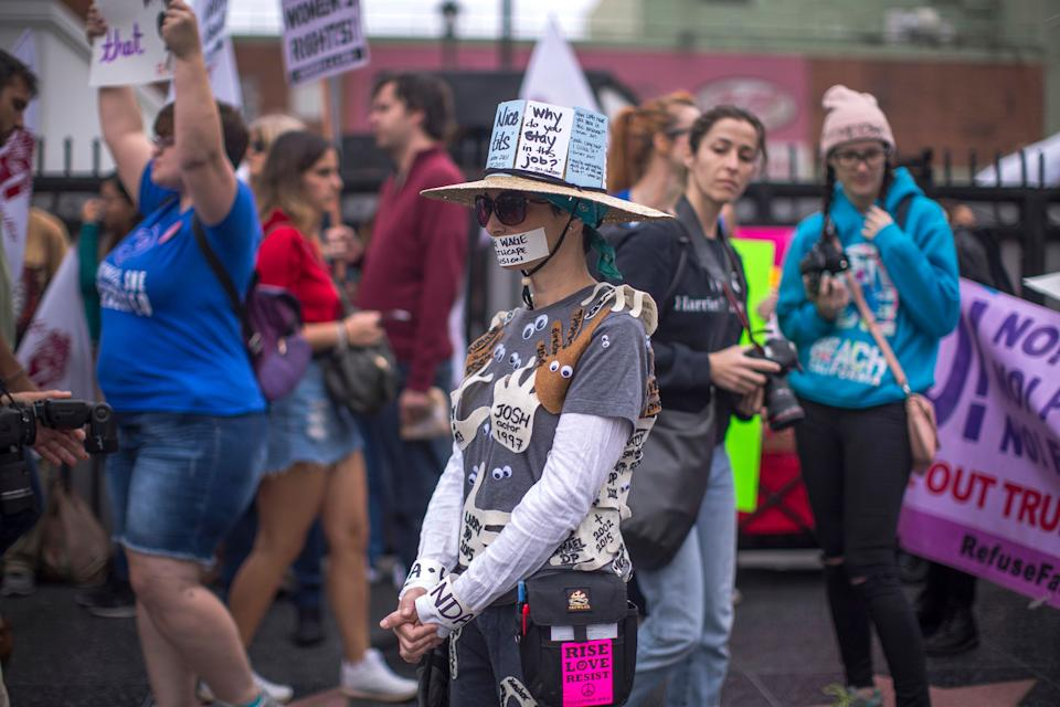 A protester covered her body in messages condemning sexual assault.