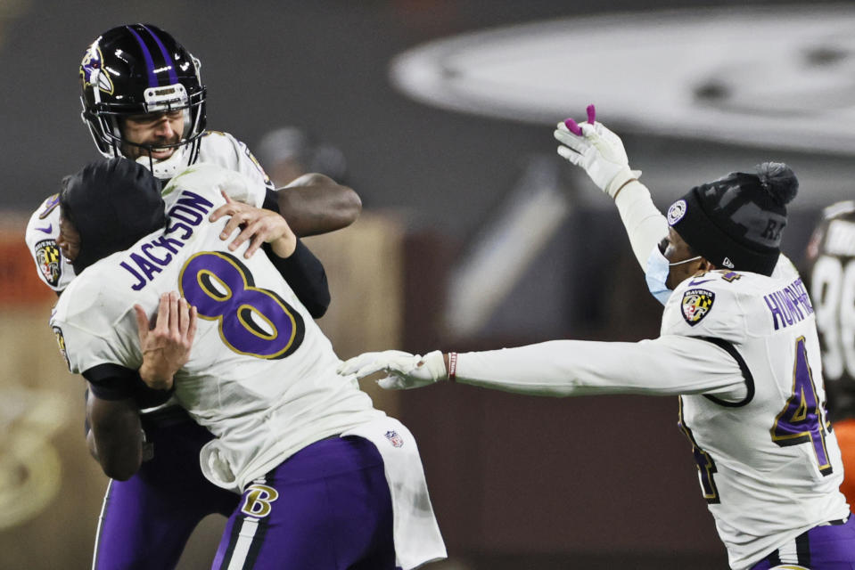 Baltimore Ravens quarterback Lamar Jackson (8) celebrates with kicker Justin Tucker (9) after Tucker kicked a field goal in the second half of an NFL football game against the Cleveland Browns, Monday December 14, 2020 in Cleveland.  The Ravens won 47-42.  (AP Photo / Ron Schwane)
