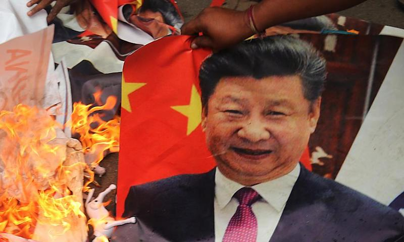 A protest against China in Bengaluru, where pictures of Xi Jinping were burnt.