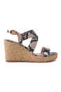 """<p><strong>Stuart Weitzman</strong></p><p>net-a-porter.com</p><p><strong>$475.00</strong></p><p><a href=""""https://go.redirectingat.com?id=74968X1596630&url=https%3A%2F%2Fwww.net-a-porter.com%2Fen-us%2Fshop%2Fproduct%2Fstuart-weitzman%2Fellette-snake-effect-leather-espadrille-wedge-sandals%2F1237348&sref=https%3A%2F%2Fwww.marieclaire.com%2Ffashion%2Fg34126792%2Fspring-shoe-trends-2021%2F"""" rel=""""nofollow noopener"""" target=""""_blank"""" data-ylk=""""slk:Shop Now"""" class=""""link rapid-noclick-resp"""">Shop Now</a></p><p>An espadrille wedge is an easy way to boost your height and the python-print trim make them a bit more sexy.</p>"""