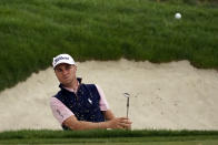 Justin Thomas hits from bunker to the second green during the third round of the Zozo Championship golf tournament Saturday, Oct. 24, 2020, in Thousand Oaks, Calif. (AP Photo/Marcio Jose Sanchez)