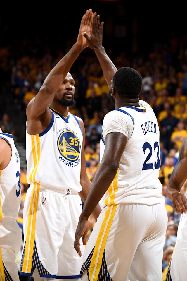 OAKLAND, CA - MAY 8: Kevin Durant #35 and Draymond Green #23 of the Golden State Warriors high five during the game against the New Orleans Pelicans in Game Five of the Western Conference Semifinals of the 2018 NBA Playoffs on May 8, 2018 at Oracle Arena in Oakland, California. (Photo by Garrett Ellwood/NBAE via Getty Images)