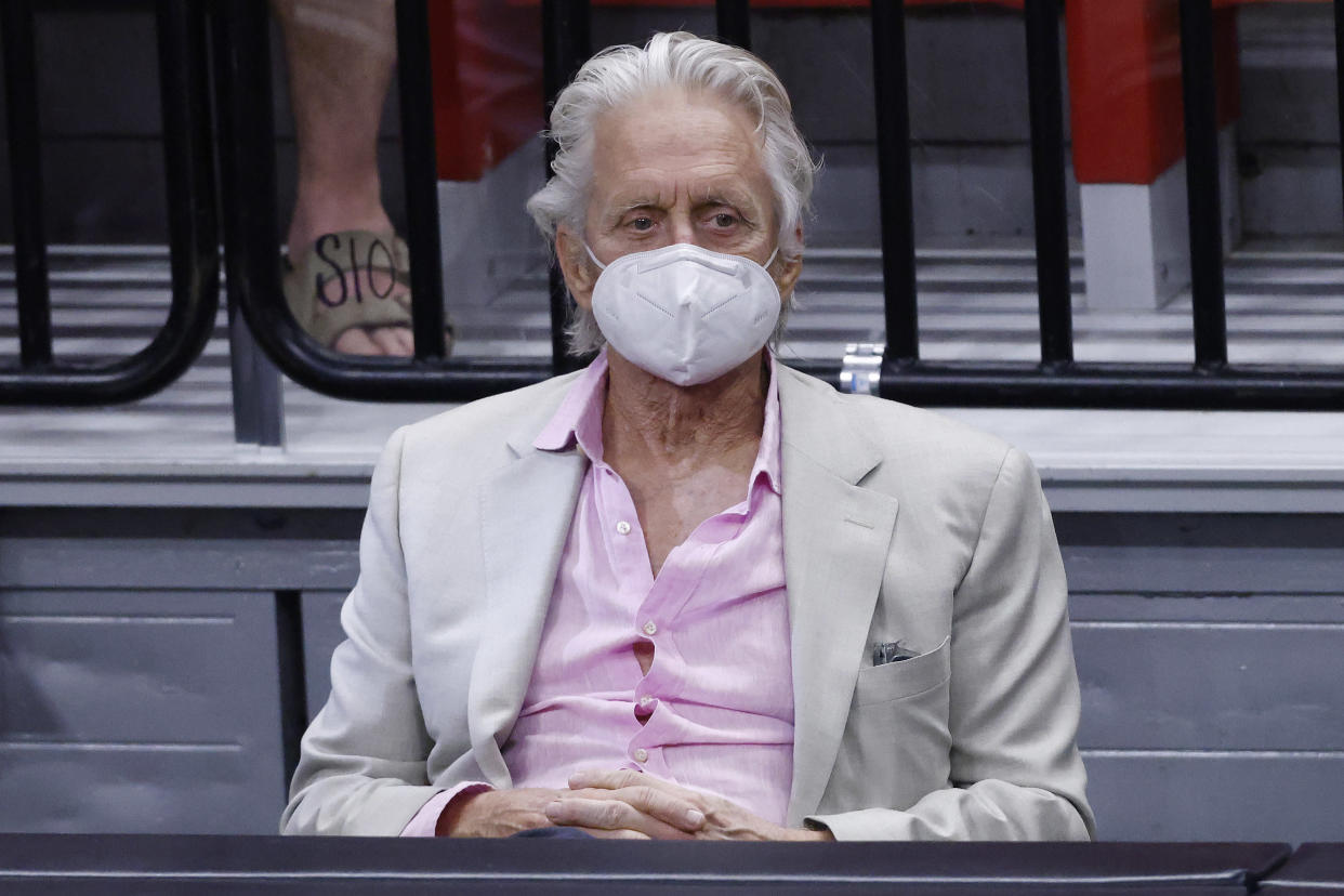 MIAMI, FLORIDA - APRIL 24: Actor Michael Douglas watches play between the Miami Heat and the Chicago Bulls during the fourth quarter at American Airlines Arena on April 24, 2021 in Miami, Florida. NOTE TO USER: User expressly acknowledges and agrees that, by downloading and or using this photograph, User is consenting to the terms and conditions of the Getty Images License Agreement. ( (Photo by Michael Reaves/Getty Images)