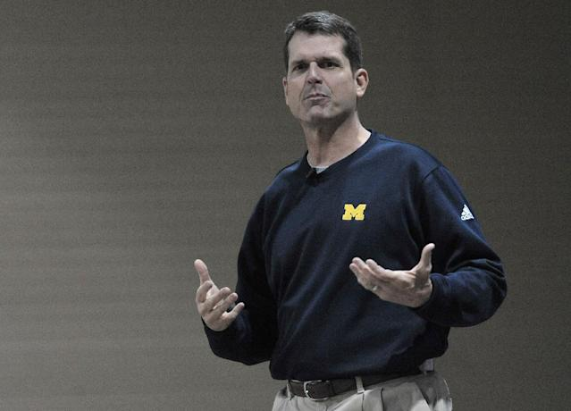 Michigan head football coach Jim Harbaugh speaks at the Michigan High School Football Coaches Association, Friday morning, Jan. 16, 2015 at the Lansing Civic Center in Lansing, Mich. (AP Photo/Detroit News, Dale G. Young)