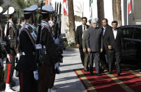 Indian Prime Minister Manmohan Singh, second right, reviews an honor guard, as he is welcomed by Iranian President Mahmoud Ahmadinejad, right, for their meeting in Tehran, Iran, Wednesday, Aug. 29, 2012. (AP Photo/Vahid Salemi)