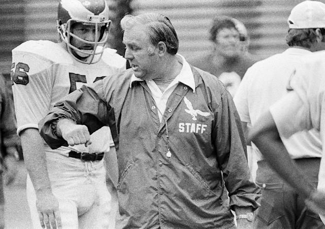FILE - In this Sept. 19, 1975, file photo, Philadelphia Eagles head coach Mike McCormack demonstrates what he means to Eagles' linebacker Dean Halverson during an NFL football workout at Veterans Stadium in Philadelphia. McCormack, a Hall of Fame offensive lineman died Fridaym, Nov. 15, 2013, in Palm Desert, Calif. He was 83. During his nearly 50 years in professional football, McCormack played, coached and held several executive positions. (AP Photo/Rusty Kennedy, File)