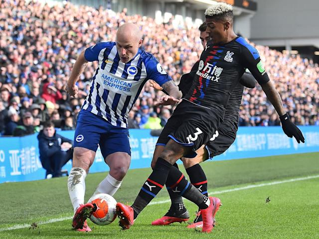 Brighton's Aaron Mooy vies with Crystal Palace's Patrick van Aanhol: AFP via Getty Images