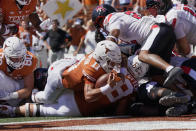 Texas quarterback Casey Thompson (11) lunges into the end zone for a touchdown against Texas Tech during the first half of an NCAA college football game on Saturday, Sept. 25, 2021, in Austin, Texas. (AP Photo/Chuck Burton)
