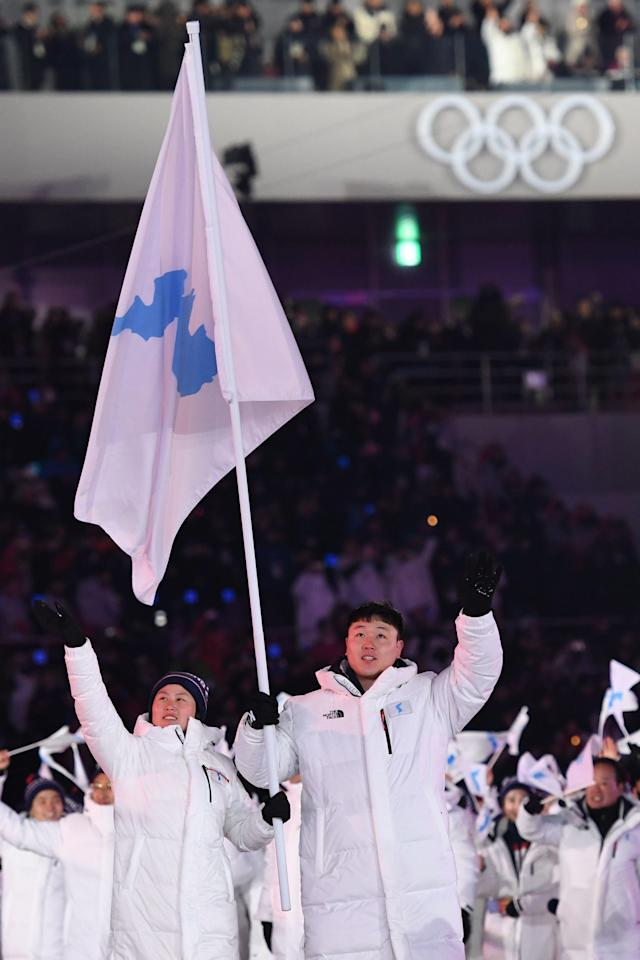 Unified Korea's flag bearers lead the delegation parade during the opening ceremony of the 2018 Winter Olympic Games on February 9, 2018. (KIRILL KUDRYAVTSEV via Getty Images)