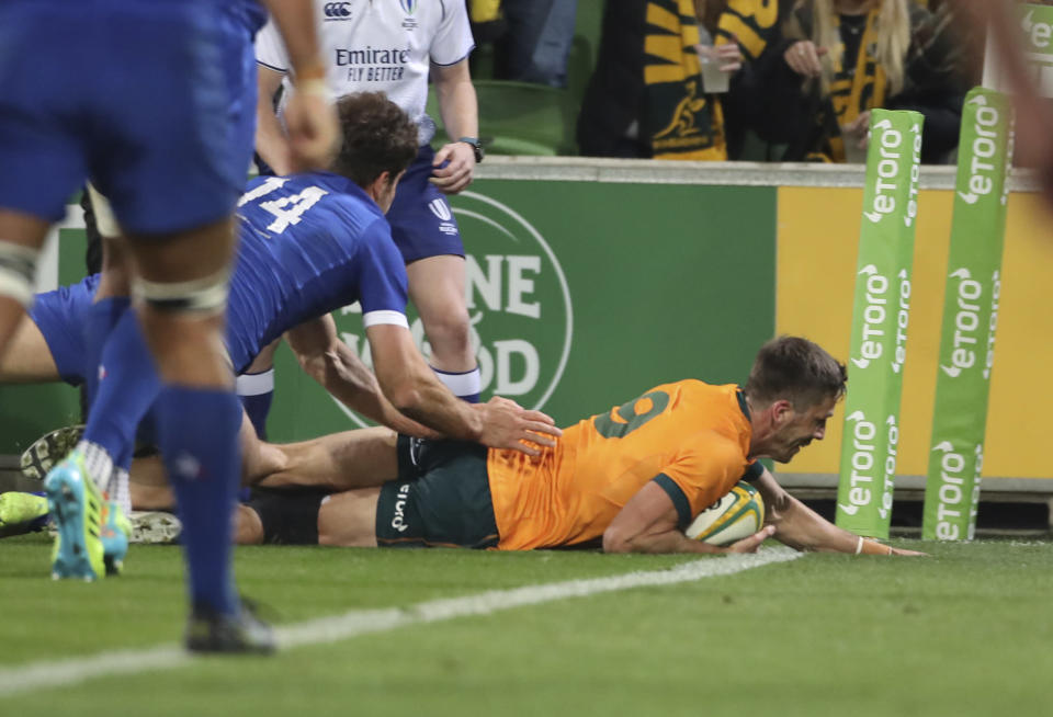 Australia's Jake Gordon scores his team's first try during the second rugby test between France and Australia in Melbourne, Australia, Tuesday, July 13, 2021. (AP Photo/Asanka Brendon Ratnayake)