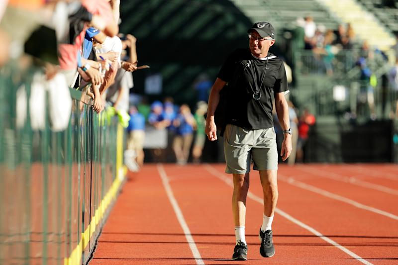 EUGENE, OR - JULY 01: Coach Alberto Salazar looks on as Galen Rupp celebrates after winning the Men's 10000 Meter Final during the 2016 U.S. Olympic Track & Field Team Trials at Hayward Field on July 1, 2016 in Eugene, Oregon. (Photo by Andy Lyons/Getty Images)