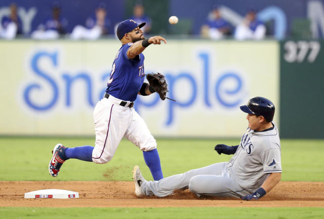 Texas Rangers second baseman Rougned Odor (12) throws to first after forcing out Tampa Bay Rays' Ji-Man Choi during the second inning of a baseball game Tuesday, Sept. 10, 2019, in Arlington, Texas. Willy Adames was safe at first. (AP Photo/Richard W. Rodriguez)