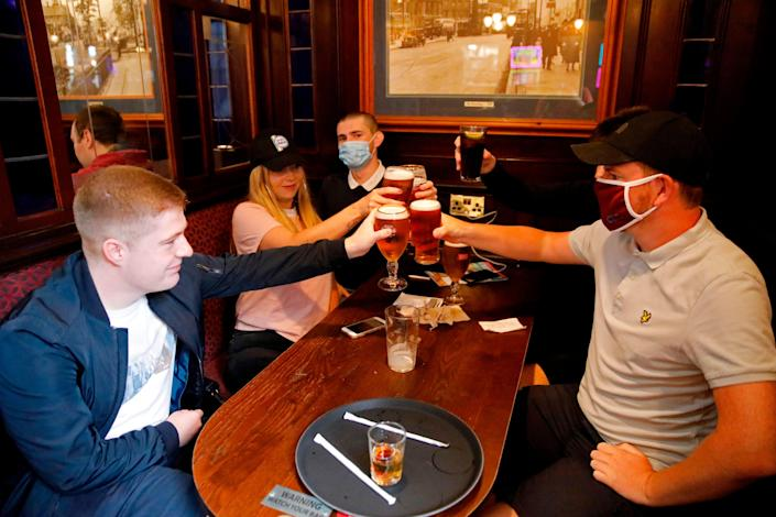 <p>Pubs will be allowed to serve food and drinks indoors for the first time since last year</p> (AFP via Getty Images)