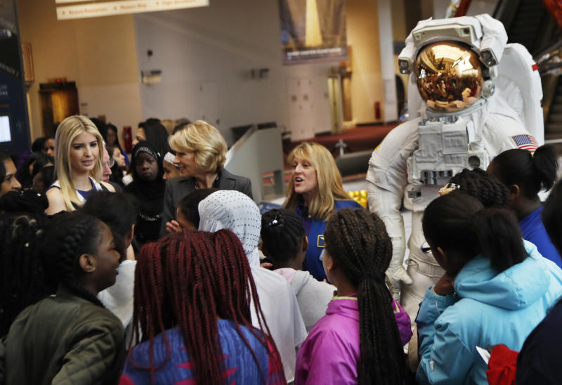 Ivanka Trump, left, Education Secretary Betsy DeVos, center, listens as NASA Astronaut Kay Hire speaks to female students at the Smithsonian's National Air and Space Museum in Washington, Tuesday, March 28, 2017, to celebrate Women's History Month. (AP Photo/Manuel Balce Ceneta)