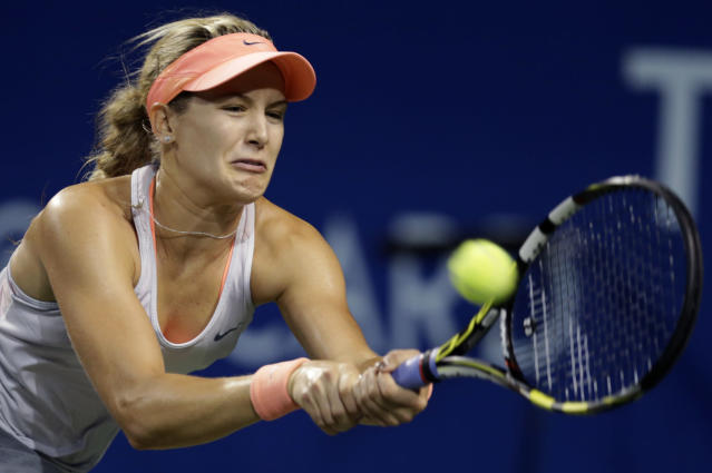 Eugenie Bouchard of Canada returns the ball against Serbia's Jelena Jankovic during their third round match of the Pan Pacific Open tennis tournament in Tokyo, Wednesday, Sept. 25, 2013. (AP Photo/Shizuo Kambayashi)