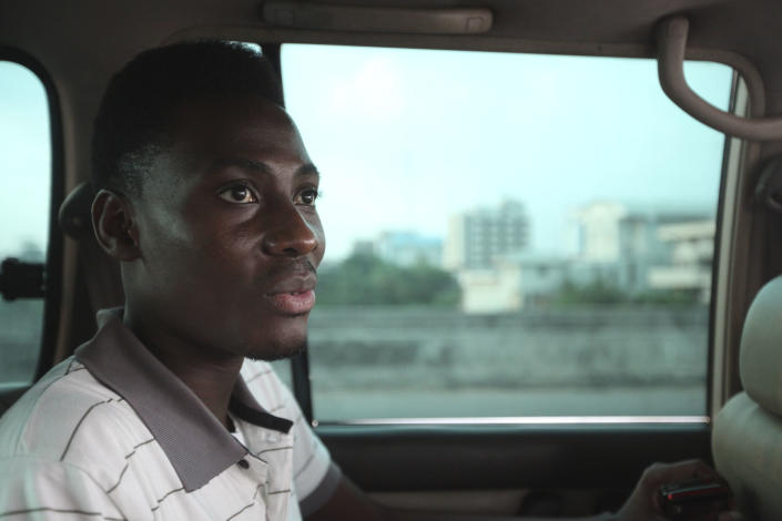FILE - In this Wednesday, Nov. 17, 2011 file photo, Rashidi Williams, a gay man, rides in a car in Lagos, Nigeria. Local and international groups fighting AIDS warned on Tuesday, Jan. 14, 2014, that a new Nigerian law criminalizing same-sex marriage and gay organizations will jeopardize the fight against the deadly disease. Human rights activists reported that dozens of gay men were being arrested in northern Nigeria in an apparent response to the law. (AP Photo/Sunday Alamba, File)