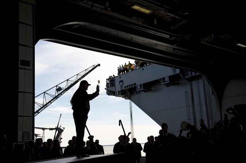 US President Donald Trump waves as he arrives to speak aboard the pre-commissioned USS Gerald R. Ford aircraft carrier in Newport News, Virginia, March 2, 2017 (AFP Photo/SAUL LOEB)