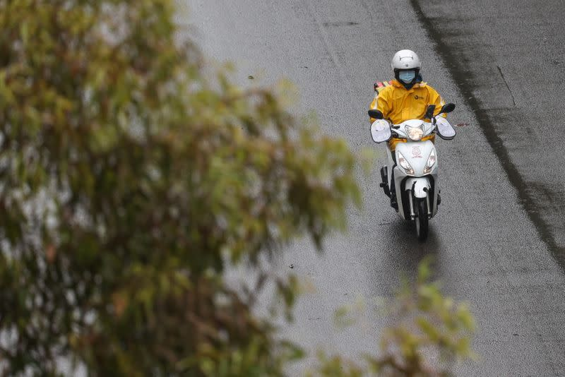 A delivery courier wears a mask in Sydney