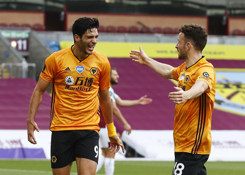 """Soccer Football - Premier League - Burnley v Wolverhampton Wanderers - Turf Moor, Burnley, Britain - July 15, 2020 Wolverhampton Wanderers' Raul Jimenez celebrates scoring their first goal with Diogo Jota, as play resumes behind closed doors following the outbreak of the coronavirus disease (COVID-19) REUTERS / Jason Cairnduff / Pool EDITORIAL USE ONLY. No use with unauthorized audio, video, data, fixture lists, club/league logos or """"live"""" services. Online in-match use limited to 75 images, no video emulation. No use in betting, games or single club/league/player publications. Please contact your account representative for further details."""