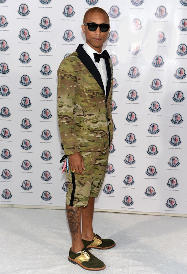 MIAMI BEACH, FL - DECEMBER 07:  Producer Pharrell Williams attends a private dinner celebrating Remo Ruffini and Moncler's 60th Anniversary during Art Basel Miami Beach on December 7, 2012 in Miami Beach, Florida.  (Photo by Dimitrios Kambouris/Getty Images for Moncler)