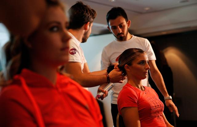 ISTANBUL, TURKEY - OCTOBER 20: Sara Errani of Italy attends the Oriflame Style Suite and has her hair done during the previews of the TEB BNP Paribas WTA Championships at the Renaissance Polat Istanbul Hotel on October 20, 2013 in Istanbul, Turkey. (Photo by Dean Mouhtaropoulos/Getty Images)